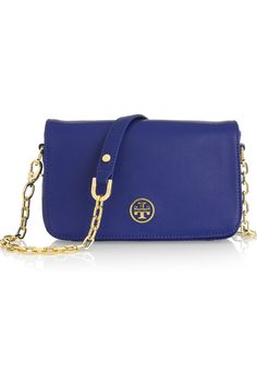 Tory Burch!  Love the bright color with gold hardware!