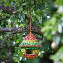 Round Recycled Woven bird house - Traidcraft - This delightful fair trade round hanging bird house has been handmade using recycled sweet wrappers to create a beautiful multi-coloured design. Sweet Wrappers, Spiritual Garden, Fair Trade Clothing, House Made, Craft Kits, Home Gifts, Recycling, Outdoor Decor, Outdoor Living