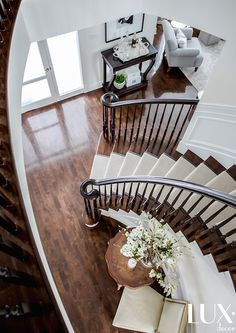 An elegant foyer features a winding staircase lined with a beige bound sisal run. An elegant foyer features a winding staircase lined with a beige bound sisal runner alongside a … Foyer Staircase, White Staircase, Staircase Runner, Winding Staircase, Entrance Foyer, Entrance Design, Entryway Decor, Round Entry Table, Sisal Runner