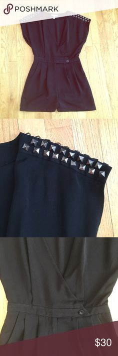 """Silence & Noise romper Black v-neck short sleeve romper with pockets and stud detail on shoulder. Measures 30"""" in length and 12.5"""" across the waist. Like new. silence + noise Pants Jumpsuits & Rompers"""