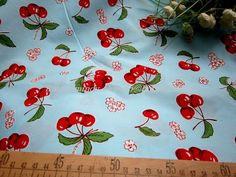 SG017 - 1 Meter Terylene Cotton Fabric - Fresh Fruits, Sweet Cherries, Pink Flowers - Light Blue. $9.50, via Etsy.