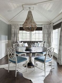 Love the capiz chandelier and chippendale chairs in this blue dining room! Click this picture to see the rest of this gorgeous home!