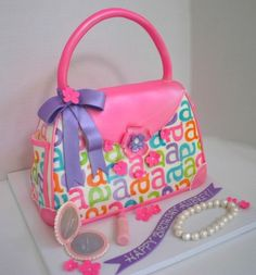 Little Girls birthday cake with compact, lipstick and pearls made of sugar