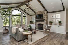 What a beautiful home! We couldn't be prouder to have our cedar beams and Jasperwood featured in this amazing space! These subtle wood finishes really bring another layer to this wonderfully designed space.  Check out more ideas on our website: www.rusticlumberco.com #wood #rustic #lumber #woodbeams #exposedbeams #exposedwoodbeams #woodaccents #island #pendantlights #stonefireplace #diy #homedecor Parade Of Homes 2017, Cedar Siding, Exposed Beams, Amazing Spaces, White Rooms, Wood Beams, Wood Accents, Coastal Cottage, Next At Home