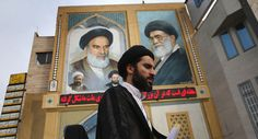 An Islamic Mullah walks past a portrait of the late Ayatollah Khomeini on June 3, 2014 in Qom, Iran. Iran is marking the 25th anniversary of the death of the Ayatollah Khomeini and his legacy of the Islamic Revolution.  (Photo by John Moore/Getty Images)