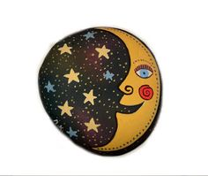 smiling moon and stars painted on a rock