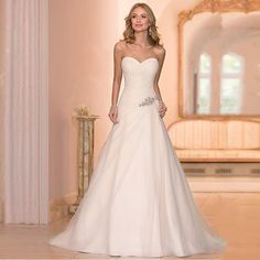 Stella York wedding dresses are handcrafted with stunning detail. This Tulle A-L… Stella York wedding dresses are handcrafted with stunning detail. This Tulle A-Line bridal gown features show stopping details such as its c… Mermaid Beach Wedding Dresses, Ruched Wedding Dress, Princess Style Wedding Dresses, Wedding Dresses Under 100, Sweetheart Wedding Dress, Country Wedding Dresses, Elegant Wedding Dress, Tulle Wedding, Designer Wedding Dresses