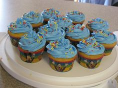 Mickey mouse cups cakes to match Zach's cake and theme