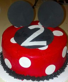 Minnie Mouse Cake- this was a 6 inch cake frosted with buttercream frosting. I colored it red using Wilton No Taste Red coloring. I decorated it using sugar sheets for the circles and the number 2. The ears are two circles from a sugar sheet pressed together around a toothpick and stuck into the cake.