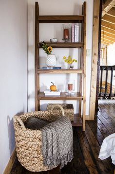 Chunky braids of rustic bankuan leaves weave a tall textural basket, ready to stow toys, towels, magazines and more.