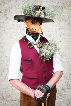 Mark Green, who works for DHL, wears a leather plague doctor's mask and bunches of gypsophila - at Weekend at the Asylum, Lincoln UK 2014
