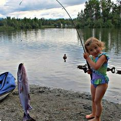 """A little girl shows off a """"pillowfish"""" at Mat-Su's Finger Lake, in this photo by Auktweena Renner."""