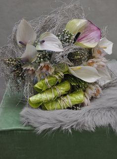 All white! Upcoming florist Angelo Giuffrida created a small bouquet and added green and purple on a white and grey base. By adding light it is an outstanding #Christmas bouquet. He mixed different varieties of #Anthurium to make it extra attractive.