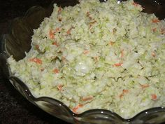 KFC Coleslaw.  Cabbage that has been put through your food processor (you want pieces the size of rice, some shredded carrot and chopped onion.  Then pour on dressing and chill. Dressing recipe: 1/3 c sugar, 1/2 tsp salt,   1/8 tsp pepper, 1/4 c milk, 1/2 c mayo,   1/4 c buttermilk, 1 1/2 tbs white vinegar,   2 1/2 tbs lemon juice.