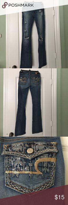 American eagle distressed denim jeans Distressed denim jeans size 00 Long but do run on the bigger side as I am a size 1 and can still wear them. American Eagle Outfitters Jeans Boot Cut
