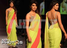 Lakme Fashion Week: The desi girl of Bollywood, Priyanka Chopra draped herself in a lemon green sari on the ramp.