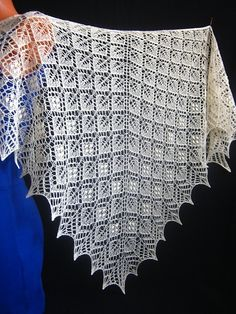 Quiet evening is a triangular shawl with traditional lace and nupp stitch patterns.