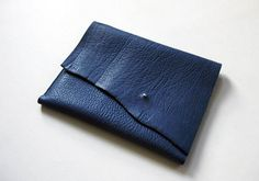 """Perfectly sized for your iPad (no matter which generation), this case is crafted from gorgeous, thick, textured indigo blue bull leather. It's also perfect for carrying around a 10"""" x 7.5"""" molskine notebook or can be used as a clutch or tool pouch. The case features a raw leather edge and metal stud closure.  From Fog + Foundry. $110"""