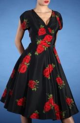 Our classic and original Rose Swing dress! So vintage and beatiful. Made of a gorgeous rose print drapey fabric that feels glamorous to the touch. The fabric has little to no stretch, if you are in between sizes, please order up. Dress is fully lined. Off the shoulder (kimono) sleeves are very accentuating to your neckline. Overlapping bust detail shows the perfectly modest amount of skin. Midriff and waist are fitted, and fall into a full swing skirt. Perfect for any special occasion.