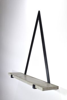 The Concrete Triangle Shelf is a beautiful and simple item which we are thrilled to have in our store. This elegant design would be perfect as a centre point of any room with a selection of styled home accessories adorning the shelf. The polished handmade Concrete Furniture, Concrete Projects, Industrial Furniture, Diy Furniture, Furniture Design, Mirrored Furniture, Repurposed Furniture, Furniture Stores, Furniture Makeover
