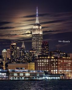 Supermoon enlightening the Empire State Building by Peter Alessandria @palessandria - The Best Photos and Videos of New York City including the Statue of Liberty, Brooklyn Bridge, Central Park, Empire State Building, Chrysler Building and other popular New York places and attractions.