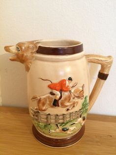 Vintage KSP Keele Street Pottery England Earthenware Hunting Scene Jug with Fox Head Spout.  In excellent condition for age. No chips, No cracks, No crazing, No repairs. In clean and tidy condition only few minor loss of paintwork please see pictures. Impressed mark KSP England (see picture).  approx. 15 cm tall, rim 6.5 x 6.5cm, base 6 x 6cm. Please study all the pictures for your own impressions? Please contact me with any inquiry. When receiving your item I would really appreciate you…