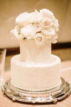 Classic white rose topped wedding cake: http://www.stylemepretty.com/2016/05/27/classic-houston-wedding/ | Photography: Kayla Barker Fine Art Photography - http://www.kaylabarker.com/