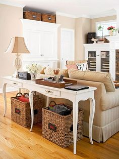 sofa table behind couch is a great decorating idea for a living room