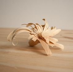 """Quickly formed wood flower and spoons that were meant to be tossed in the fire after they were used and enjoyed ..."""
