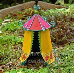 A whimsical tent with a fairy gypsy theme for your miniature garden.