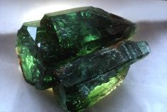 Emerald.  The beautiful common gemstone belongs to the beryl family and gets its green coloring from traces of chromium and vanadium. Many are treated with oils to enhance their color. It is a fairly hard stone.