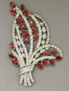 Giant 1930s/40s ruby and clear rhinestones flower spray brooch, USA - Glitzmuseum