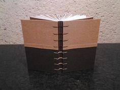 Encuadernación en tela  Costura copta  14 x 21.7  160 hojas  Papel bond