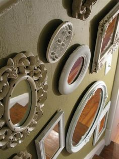 i LOVE lots of different mirrors! Very cool way to decorate a wall while making the room seem bigger! :)