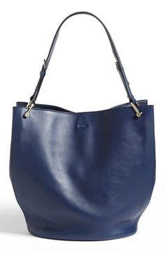 $1,425, Navy Leather Tote Bag: Tod's Secchiello Leather Tote Navy Blue. Sold by Nordstrom. Click for more info: https://lookastic.com/women/shop_items/227363/redirect