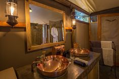 Little Makalolo comprises six traditional-style tents overlooking a vibrant waterhole, offering excellent game viewing in Hwange National Park, Zimbabwe. Tour Operator, Wilderness, Safari, National Parks, Camping, Refurbishment, Traditional, Zimbabwe, Mirror