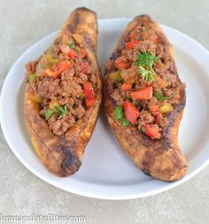 I love plantains, and finally figured out where i could get them on a consistent basis...Stuffed Baked Plantains. Ooh! I love making my stuffed zucchinis. This could be a fun change.