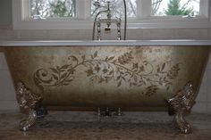 Painted & stenciled claw-foot tub - charming!