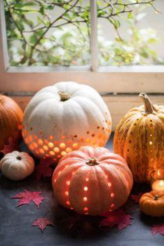 Drill holes to make pumpkin lanterns