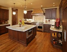 Image detail for -dark stained Knotty Alder Cabinets with a light colored granite ...