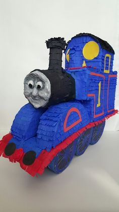 Pinata Thomas is made from cardbord, then covered whit paper mache , decorated whit crepe paper , whit attention to detail.  Size :70x65 cm  Pinata