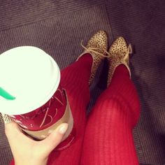 I like the printed shoe, red tights combo!