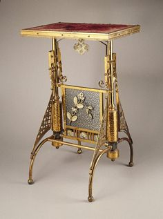 Table                                                                                 Maker: The Charles Parker Company Medium: Brass, other metals, wood, fabric Dates: ca. 1880
