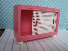 Barbie Furniture  Entertainment Cabinet by DebsDollRoomDesigns, $20.95. (DYI - if not wood box, use cardboard/box to build; doors made of plastic canvas, feet made of beads - kj )