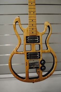 Peavey T-60. Interesting look but I think whoever modded this cut too much of the wood away.
