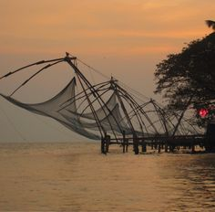 Cochin fishing nets at dusk. Cochin is also called Kochi and is a bustling town with lots of places to sit back and enjoy. Photo taken in Kochi, Kerala, India