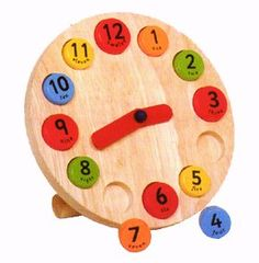 Google Image Result for http://woodentoyscenter.net/wp-content/uploads/2011/06/children-wooden-toys-clock.jpg