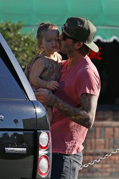 The time David planted a smacker on Harper's cheek. | These Photos Of David And Harper Beckham Will Melt Your Heart