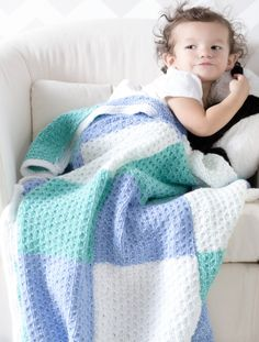 """Free download. Premier® Color Block Baby Blanket in spot stitch. Needles: US Size 8 (5mm) knittng needles or size needed to obtain gauge. GAUGE 16 sts x 24 rows = 4"""" in Spot stitch. STITCH GUIDE Spot Stitch (multiple of 4 sts) Row 1 (WS): *P1, k1, p2; rep from * to end. Rows 2 and 4 (RS): Knit. Row 3: * P3, k1; rep from * to end. Rep Rows 1-4 for pattern."""