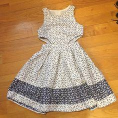 NWT ASOS PETITE FIT/FLARE FLORAL DRESS W/ CUTOUTS ASOS petite fit and flare dress with cutouts. Size 2 ASOS Dresses